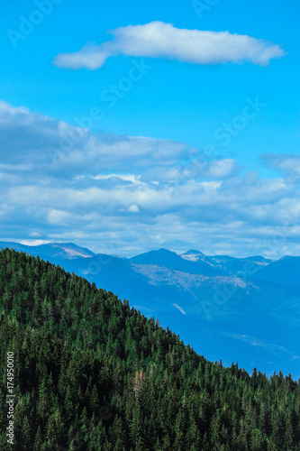 Foto op Aluminium Blauw Beautiful view on the high green mountains peaks, on the blue sky background. Alpine Mountain hiking paradise landscape, no people.