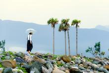 Asian Lady With Umbrella Walki...