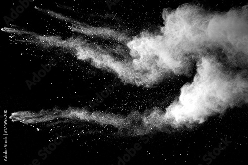 Fotografía  Explosion of white dust on black background.