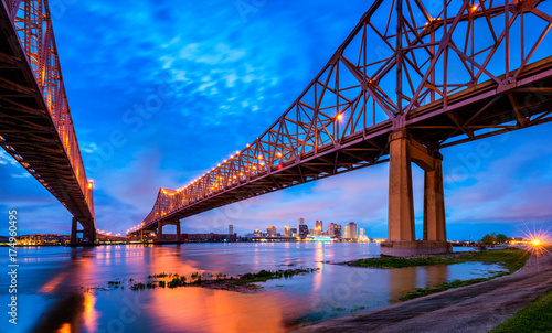 Fototapeta  Skyline of New Orleans with Mississippi River at Dusk