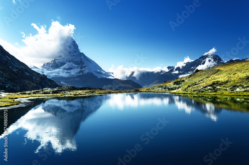 Poster Bergen Reflection of Matterhorn in lake, Zermatt, Switzerland