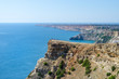 Fiolent Cape Crimea Black Sea. Blue azure seaside with corals sand and stones