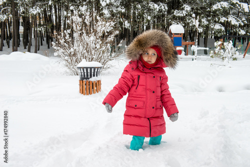 Fotografie, Obraz  cute girl is playing with snow