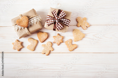 Garden Poster Cookies Christmas decoration with gingerbreads and gift boxes.Wooden background.Holiday,new year concept.Top view.