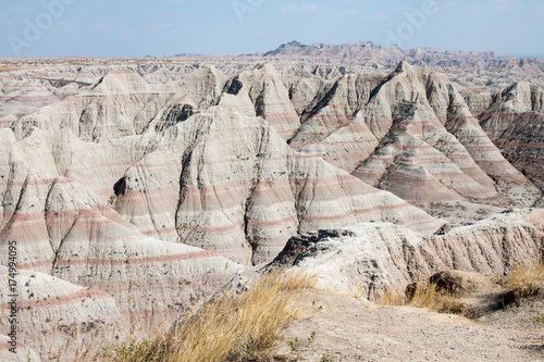 Fotografie, Obraz  Tan, arid land in the Badlands National Park in South Dakota