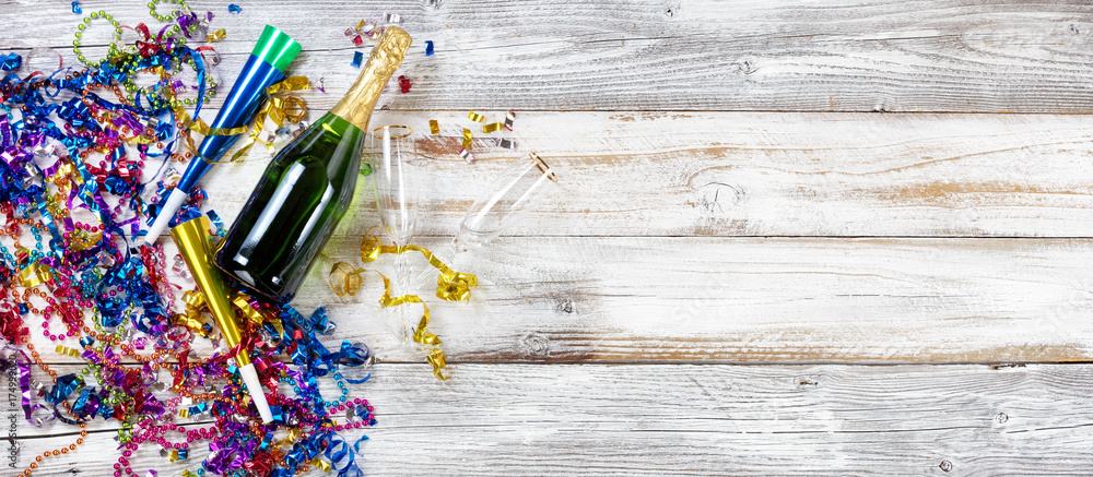 Photo  New Year party decorations and champagne on rustic white wood