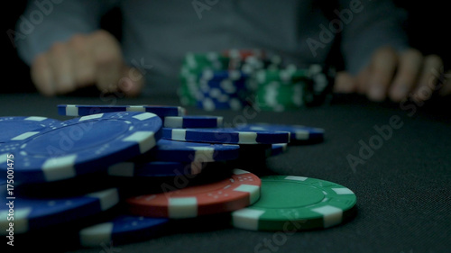 Fotografie, Obraz  Close-Up of Man Throwing a Poker Chips in slow motion