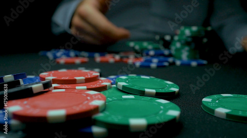 Photo Close-Up of Man Throwing a Poker Chips in slow motion