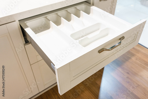 Spoed Foto op Canvas Trappen Opening drawer for Silver cutlery, focus on kitchenware