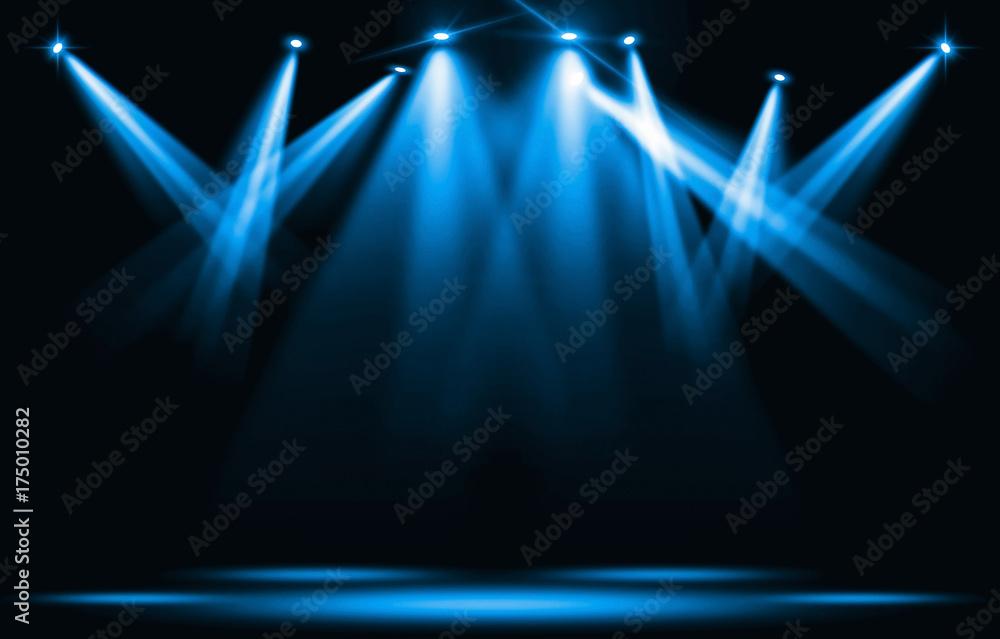Fototapety, obrazy: Stage lights. Blue spotlight strike through the darkness.
