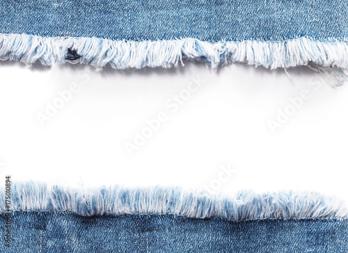 Tablou Canvas Edge frame of blue denim jeans ripped over white background.