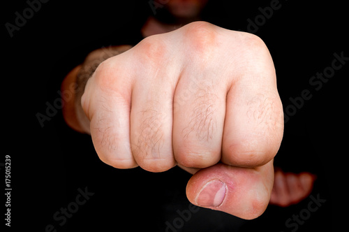 Staande foto Vechtsport Young boxer showing punch a fist - martial arts concept