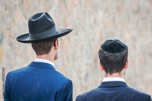 Two adult Hasidim in traditional Jewish headdresses hat and kippah. Prayer  of Hasidim. 2fbf59617da