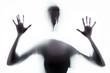canvas print picture - der Schatten einer panischen Frau hinter einem weißen Tuch