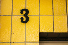Number 3 Door Sign On Yellow F...
