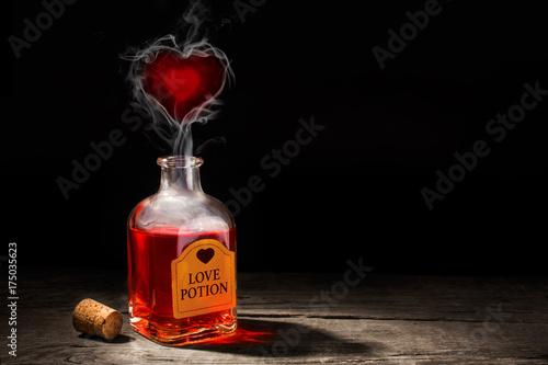 Love potion is red in a bottle Wallpaper Mural