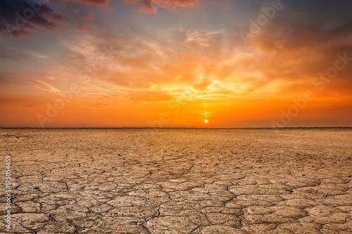 Poster de jardin Desert de sable Cracked earth soil sunset landscape