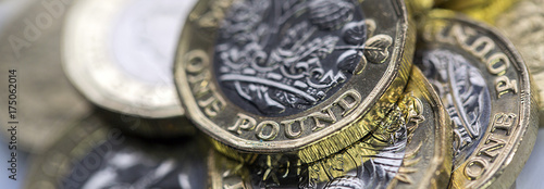 Fotografie, Obraz Selective Focus of the New UK One Pound Coin in panoramic format