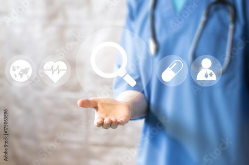 Fotografia  Doctor pushing button search magnifier loupe service virtual healthcare in network medicine
