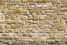 Antique (old) Natural Stone Wall, Background, Texture Or Pattern. Stone Wall Rustic Texture. Wall With Bricks Of Italian Stones.