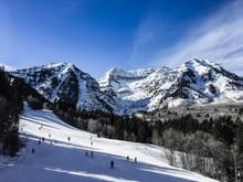 People Skiing Down A Mountain In Sundance