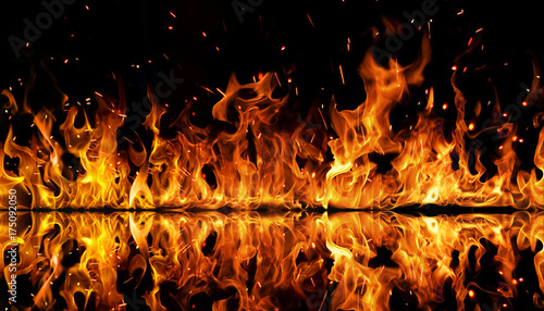 Photo  The texture of fire on a black background is reflected in a glossy table