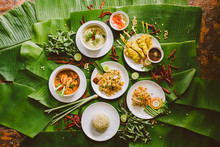 Variety Of Authentic Thai Traditional Meal Set On Green Banana Leaves