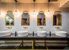 Sinks Mirrors And Lamps In Public Toilet