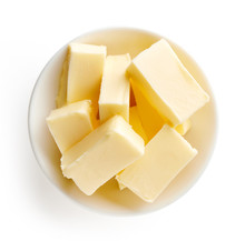 Butter Pieces In Bowl Isolated...