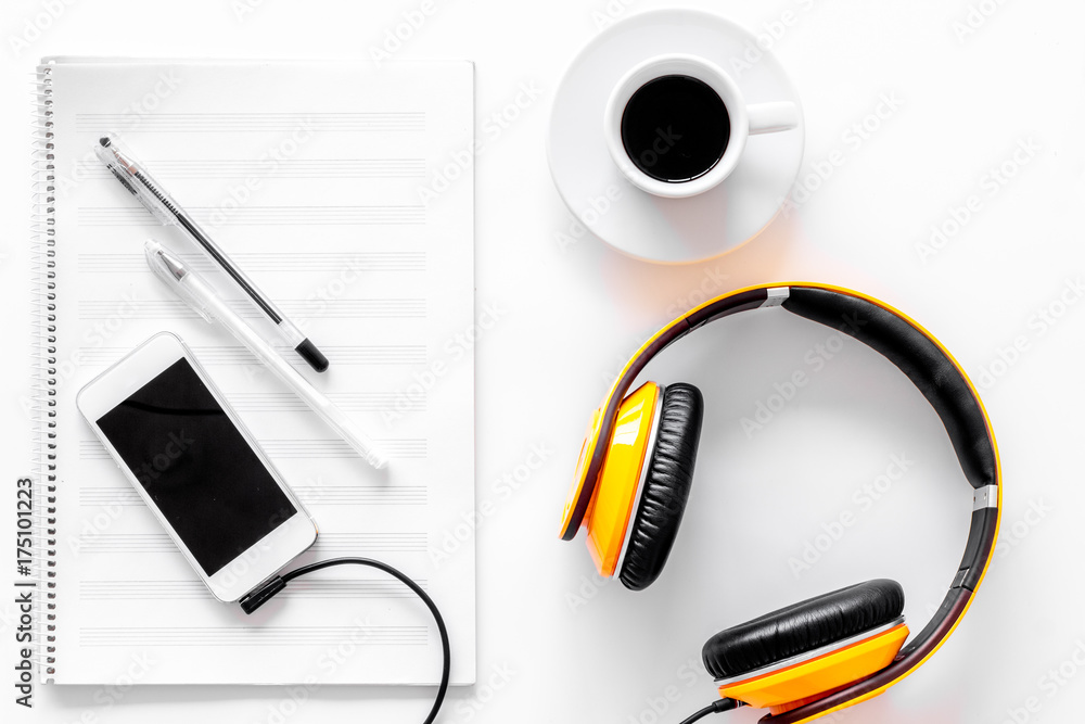 Fototapeta Compose music. Headphones, music notes, phone and coffee on white background top view - obraz na płótnie