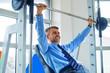 Sporty businessman,training in gym