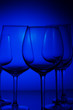 canvas print picture - Set of wine glasses on dark blue background close up