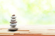 zen stones on wooden in the garden. Concept relaxation, zen, spring, spa.