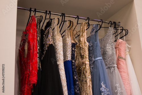 Many ladies evening gown long dresses on hanger in the dress