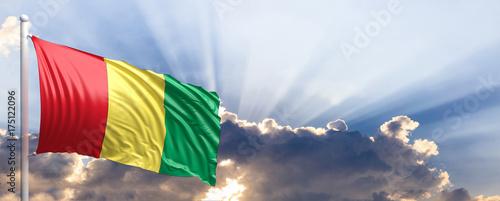 Cuadros en Lienzo Guinea flag on blue sky. 3d illustration