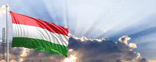 Fotografia  Hungary flag on blue sky. 3d illustration