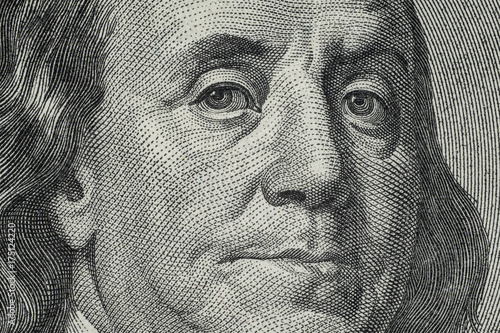 Fototapeta Close up on US dollar banknotes.  Portrait of Franklin on US dollar Banknotes. Shooting by 1:1 Macro lense. obraz