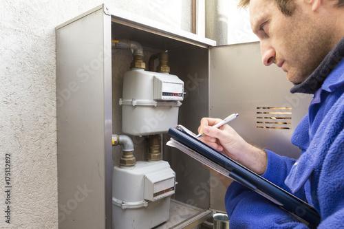 Fotografie, Obraz  plumber at work making the consumption metering