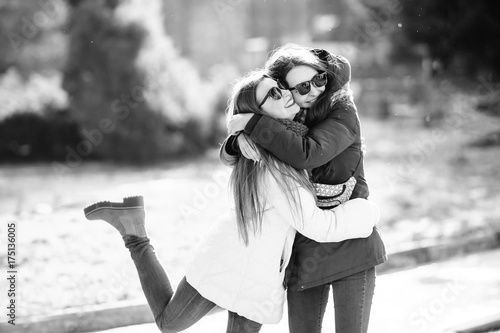 Tablou Canvas love, friendship and people concept - two happy sisters hugging