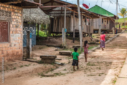 Children walking along dirt path in Amazon village