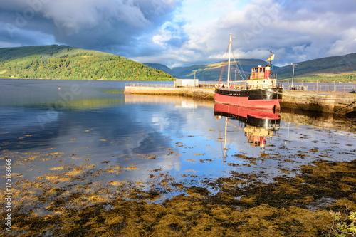 Sunset and boat on Loch Fyfe at Inveraray, Scotland Wallpaper Mural