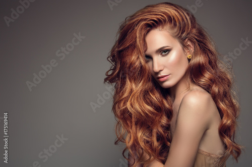 Portrait of woman with long curly beautiful ginger hair. Canvas Print