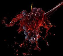 Grapes In Red Wine Splash On A Black Background