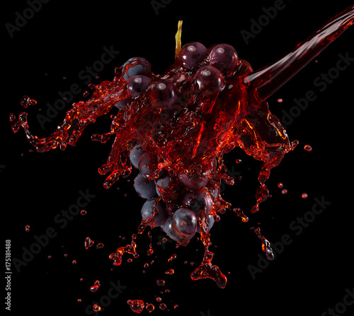 Fényképezés  grapes in red wine splash on a black background