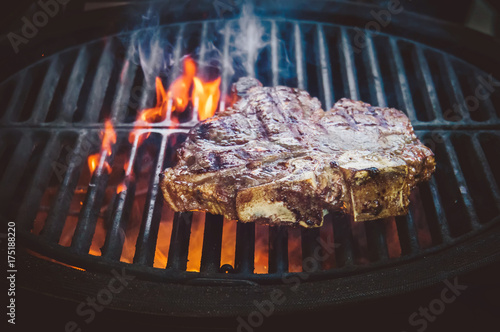 In de dag Grill / Barbecue Steak ribi black angus grilled stripes smoke steam charcoal frying