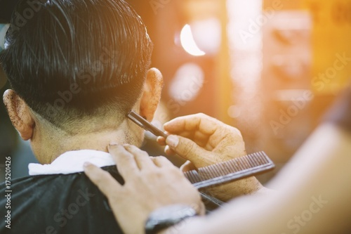 person man haircut getting stylish hair vintage shaving, , with razor by barber hairdresser with hands at barbershop Canvas Print