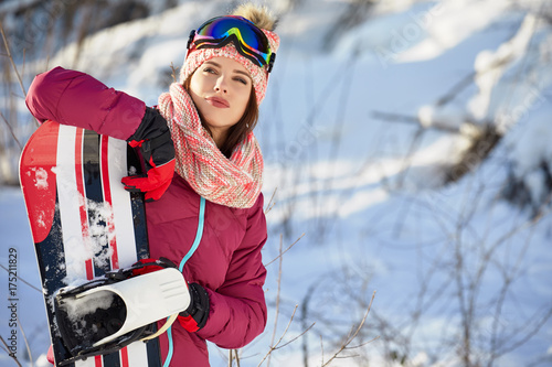 Poster Winter sports Sport woman snowboarder on snow background