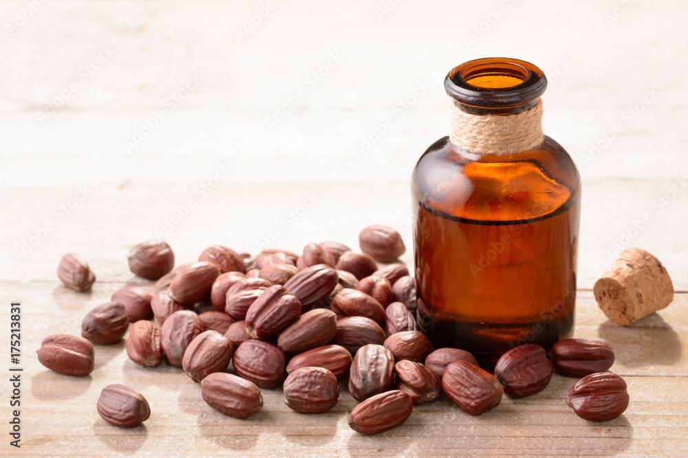 Fototapety, obrazy: Jojoba oil in the glass bottle