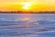 sunset over a snowbound winter plain