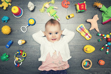 Cute Baby Girl With Lot Of Toy...